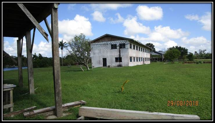 SCHOOL BUILDING NEEDING PAINTING AND WINDOWS